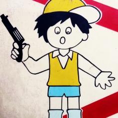 1 boy with gun