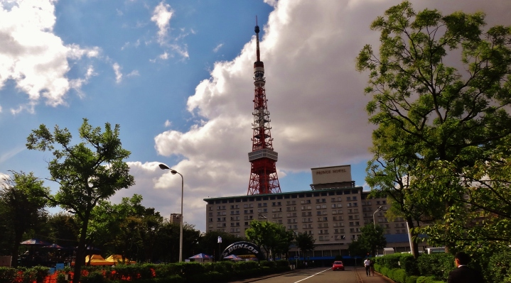 Tokyo Tower on a sunny day, with the Prince Hotel in the foreground.