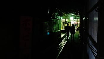 9. Couple walking in dark tunnel