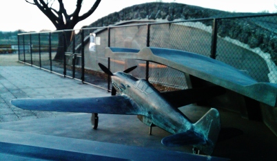"Model of a Kawasaki Ki-61 Hien ""flying swallow"", a.k.a. Ki-61 ""Tony"") at the OHSAWA Wartime Concrete Aircraft Hangars in outer Tokyo."