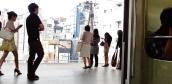 Nakameguro women waiting for train Tokyo