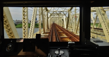 View from the front of a train crossing the Saitama river, after leavingTokyo.