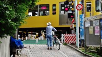 Toshima Tokyo train crossing old woman