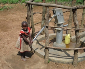 Clearwater Initiative Uganda girl water pump well