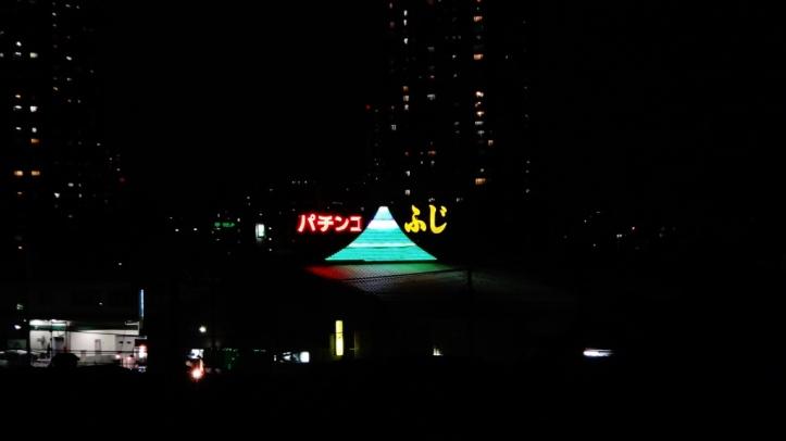 Fuji Pachinko neon Kawaguchi Tokyo from river