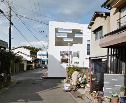 Woman near House N by Sou Fujimoto; Oita, Japan