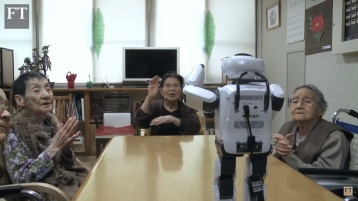 Elderly Japanese dancing and singing with a robot.