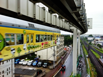 Chiba Urban Monorail leaving station yellow