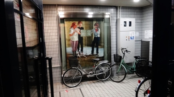 bikes at rest building entranceway Kobe Japan