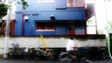 man bikes in front of other bikes Tokyo