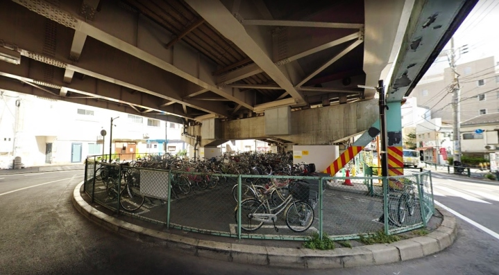 Oimachi bike parking under a highway